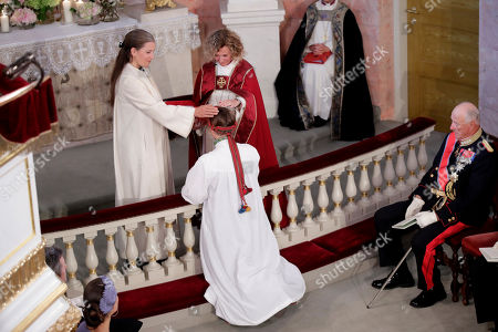 Norway's Princess Ingrid Alexandra (C) is being confirmed by Vicar Karoline Astrup (L) and Bishop Kari Veiteberg in the Palace Chapel in Oslo, Norway, 31 August 2019. The 15-year-old daugther of of Crown Prince Haakon and Princess Mette-Marit has followed the confirmation teaching in the Asker congregation. Princess Ingrid Alexandra is second-in-line to the Norwegian throne after her father.