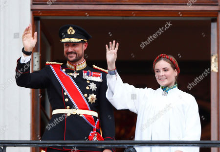 Norway's Princess Ingrid Alexandra (R) and her father Crown Prince Haakon wave from the Palace balcony after the Princess's confirmation in the Palace Chapel in Oslo, Norway, 31 August 2019. The 15-year-old daugther of of Crown Prince Haakon and Princess Mette-Marit has followed the confirmation teaching in the Asker congregation. Princess Ingrid Alexandra is second-in-line to the Norwegian throne after her father.