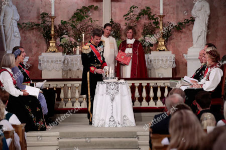 Crown Prince Frederik of Denmark in his role as godfather lights candles during the confirmation ceremony of Norway's Princess Ingrid Alexandra in the Palace Chapel in Oslo, Norway, 31 August 2019. The 15-year-old daughter of of Crown Prince Haakon and Princess Mette-Marit has followed the confirmation teaching in the Asker congregation. Princess Ingrid Alexandra is second-in-line to the Norwegian throne after her father.