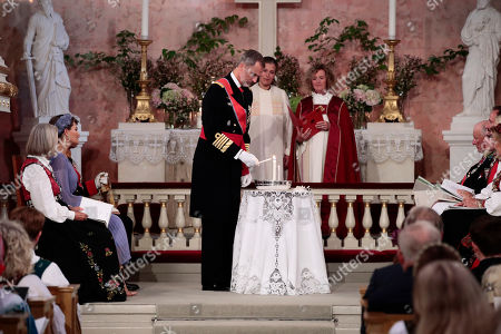 King Felipe VI of Spain in his role as godfather lights candles during the confirmation ceremony of Norway's Princess Ingrid Alexandra in the Palace Chapel in Oslo, Norway, 31 August 2019. The 15-year-old daughter of of Crown Prince Haakon and Princess Mette-Marit has followed the confirmation teaching in the Asker congregation. Princess Ingrid Alexandra is second-in-line to the Norwegian throne after her father.