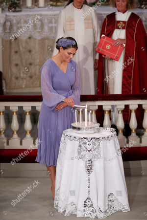 Crown Princess Victoria of Sweden in her role as godmother lights a candle during the confirmation ceremony of Norway's Princess Ingrid Alexandra in the Palace Chapel in Oslo, Norway, 31 August 2019. The 15-year-old daughter of of Crown Prince Haakon and Princess Mette-Marit has followed the confirmation teaching in the Asker congregation. Princess Ingrid Alexandra is second-in-line to the Norwegian throne after her father.
