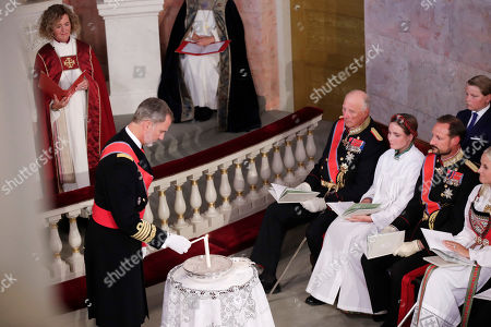 King Felipe VI of Spain (L) in his role as godfather lights a candle during the confirmation ceremony of Norway's Princess Ingrid Alexandra (4-R) in the Palace Chapel in Oslo, Norway, 31 August 2019. The 15-year-old daughter of of Crown Prince Haakon and Princess Mette-Marit has followed the confirmation teaching in the Asker congregation. Princess Ingrid Alexandra is second-in-line to the Norwegian throne after her father.