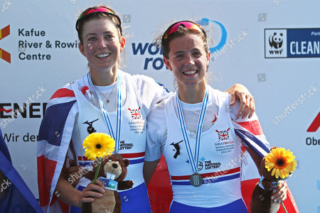 Bronze medalists Emily Craig, left, and Imogen Grant of Britain pose on the podium of the Lightweight Women's Double Sculls final at the World Rowing Championships in Ottensheim, near Linz, Austria