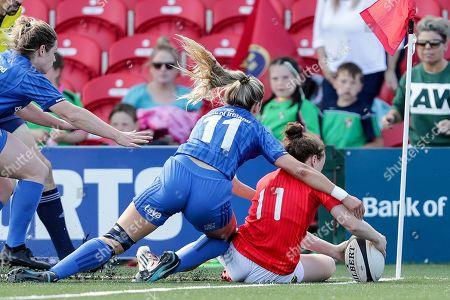 Munster Women vs Leinster Women. Munster's Laura Sheehan scores a try despite Megan Williams of Leinster