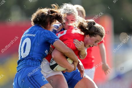 Munster Women vs Leinster Women. Munster's Enya Breen is tackled by Sene Naoupu and Megan Williams of Leinster