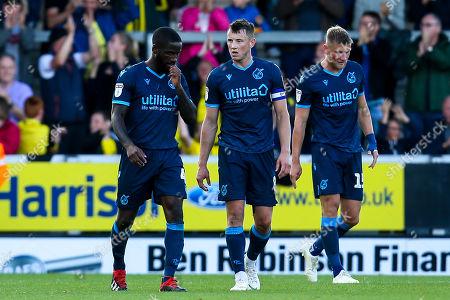 Ollie Clarke of Bristol Rovers, Abu Ogogo of Bristol Rovers and Alfie Kilgour of Bristol Rovers cut dejected figures