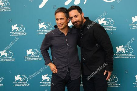 Gael Garcia Bernal, Pablo Larrain. Actor Gael Garcia Bernal, left, and director Pablo Larrain pose for photographers at the photo call for the film 'Ema' at the 76th edition of the Venice Film Festival in Venice, Italy