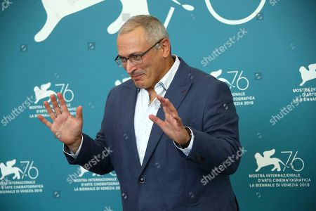 Russian oligarch Mikhail Khodorkovsky poses for photographers at the photo call for the film 'Citizen K' at the 76th edition of the Venice Film Festival in Venice, Italy