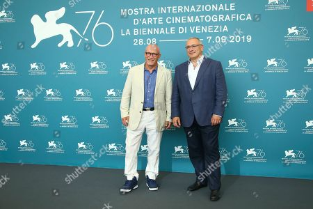 Alex Gibney, Mikhail Khodorkovsky. Director Alex Gibney, left, and Russian oligarch Mikhail Khodorkovsky poses for photographers at the photo call for the film 'Citizen K' at the 76th edition of the Venice Film Festival in Venice, Italy