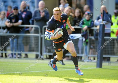 Dougie Fife - Edinburgh winger crosses the line for a first half try in the corner.