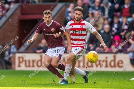 Andrew Irving (#40) of Heart of Midlothian FC and George Oakley (#9) of Hamilton Academical FC watch the ball during the Ladbrokes Scottish Premiership match between Heart of Midlothian FC and Hamilton Academical FC at Tynecastle Stadium, Edinburgh