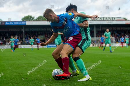 George Miller of Scunthorpe United holds off Nat Knight-Percival of Carlisle United during the EFL Sky Bet League 2 match between Scunthorpe United and Carlisle United at Sands Venue Stadium, Scunthorpe