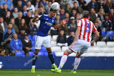 Birmingham City defender Maxime Colin (5) heads the ball under pressure from Stoke City defender Stephen Ward (3) during the EFL Sky Bet Championship match between Birmingham City and Stoke City at the Trillion Trophy Stadium, Birmingham