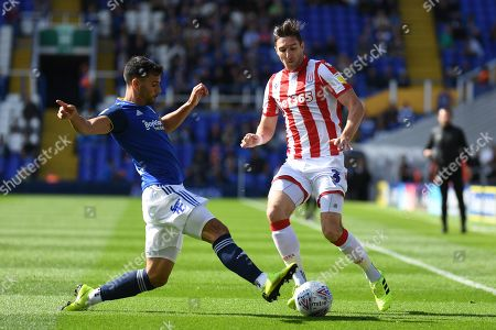Birmingham City defender Maxime Colin (5) comes in to tackle Stoke City defender Stephen Ward (3) during the EFL Sky Bet Championship match between Birmingham City and Stoke City at the Trillion Trophy Stadium, Birmingham