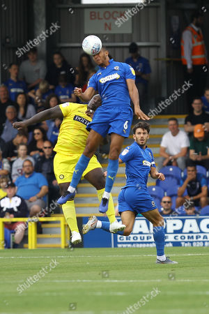 Terrell Thomas of AFC Wimbledon and Adebayo Akinfenwa of Wycombe Wanderers during AFC Wimbledon vs Wycombe Wanderers, Sky Bet EFL League 1 Football at the Cherry Red Records Stadium on 31st August 2019