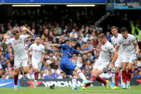 Stock Photo of Chelsea's Christian Pulisic is surrounded by Sheffield United players and loses possession to Jack O'Connell during Chelsea vs Sheffield United, Premier League Football at Stamford Bridge on 31st August 2019