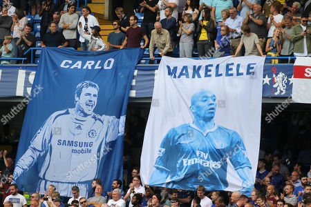 Large banners of Chelsea's Carlo Cudicini and Claude Makelele are unveiled moments ahead of kick-off during Chelsea vs Sheffield United, Premier League Football at Stamford Bridge on 31st August 2019