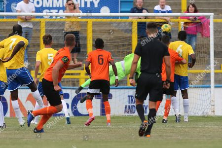 Will Gardner of Bury Town (left) watches his long range effort beat Lamar Johnson of Canvey Island to score the opening goal during Canvey Island vs Bury Town, BetVictor League North Division Football at Park Lane on 31st August 2019