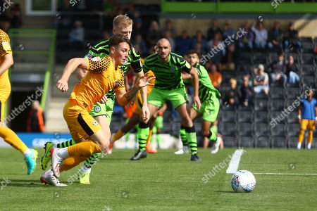 Danny McNamara of Newport County takes on Nathan McGinley of Forest Green Rovers