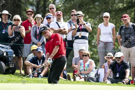 Miguel Angel Jimenez of Spain hits a bunker shot during the third round of the European Masters golf tournament in Crans-Montana, Switzerland, 31 August 2019.