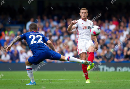 Stock Picture of Jack O'Connell of Sheffield United passes the ball past Christian Pulisic of Chelsea