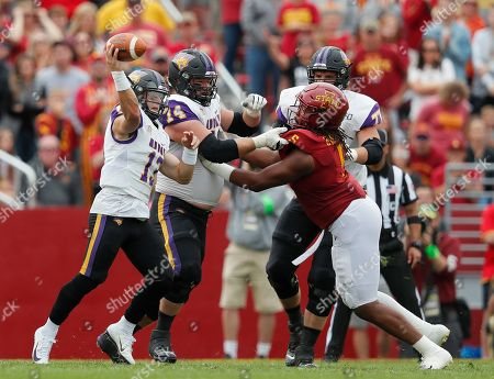 Northern Iowa offensive lineman Jackson Scott-Brown, center, blocks Iowa State defensive end Eyioma Uwazurike, right, as Northern Iowa quarterback Will McElvain, left, sends a pass downfield during the first half of an NCAA college football game, in Ames