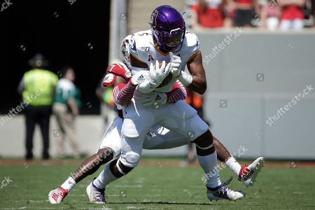 North Carolina State cornerback Chris Ingram (7) tackles East Carolina wide receiver C.J. Johnson (5) during the first half of an NCAA college football game in Raleigh, N.C