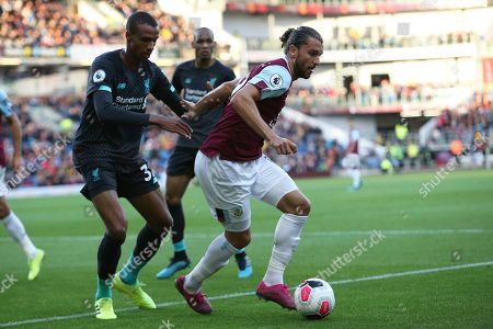 Burnley forward Jay Rodriguez (19) holds off Liverpool defender Joel Matip (32) during the Premier League match between Burnley and Liverpool at Turf Moor, Burnley