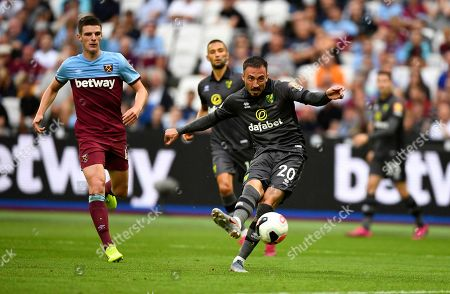 Norwich City's Josip Drmic kicks the ball during the English Premier League soccer match between West Ham United and Norwich at London Stadium in London