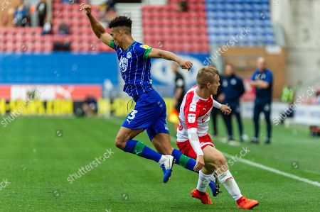 Wigan Antonee Robinson collides with Barnsley Luke Thomas during the EFL Sky Bet Championship match between Wigan Athletic and Barnsley at the DW Stadium, Wigan