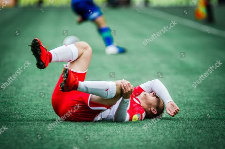Barnsley Luke Thomas goes down injured during the EFL Sky Bet Championship match between Wigan Athletic and Barnsley at the DW Stadium, Wigan