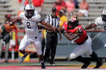 Howard quarterback Ramar Williams (2) scrambles as Maryland defensive lineman Brandon Gaddy tries to sack him during the second half of an NCAA college football game, in College Park, Md. Maryland won 79-0