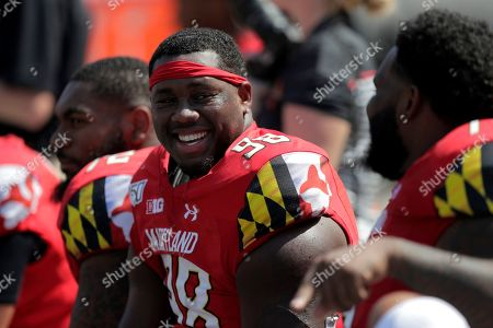 Maryland defensive lineman Brandon Gaddy talks to teammates during the second half of an NCAA college football game against Howard, in College Park, Md. Maryland won 79-0
