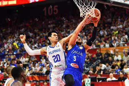 Raymond Almazan (L) of the Philippines in action against Alessandro Gentile (R) of Italy during the FIBA Basketball World Cup 2019 group D first round match between Italy and Philippines in Foshan, China, 31 August 2019.