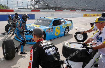 Dale Earnhardt Jr makes a pit stop during the NASCAR Xfinity Series auto race, at Darlington Raceway in Darlington, S.C
