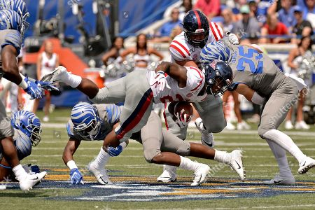 Mississippi running back Scottie Phillips (22) is tackled on a carry in the second half of an NCAA college football game against Memphis, in Memphis, Tenn