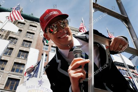 """Milo Yiannopoulos address the crowd during the Straight Pride Parade in Boston, . Several dozen marchers and about as many counter-demonstrators have gathered in Boston for a """"straight pride"""" parade. The organizers say they believe straight people are an oppressed majority"""