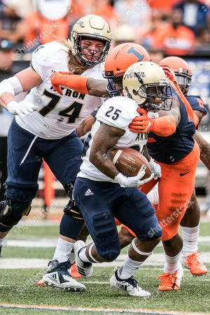 Akron's Brandon Lee (4) runs the ball in the first half of an NCAA college football game against Illinois, in Champaign, Ill