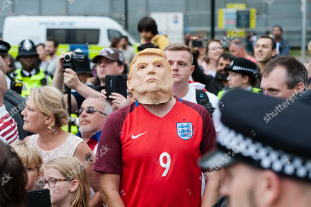 A man wearing Donald Trump mask stands with pro-Brexit and Tommy Robinson supporters in Parliament Square during a protests against the prorogation of the UK Parliament. Hundreds of thousands of people across major cities in the UK are expected to join protests against Boris Johnson's plans to suspend parliament for five weeks ahead of a Queen's Speech on 14 October, which has limited time available for MPs to legislate against a no-deal Brexit with the UK is set to leave the EU on the 31 October.