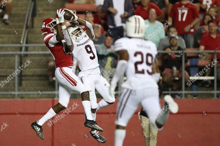 Massachusetts Minutemen cornerback Isaiah Rodgers (9) intercepts a pass intended for Rutgers Scarlet Knights wide receiver Isaiah Washington (83) during an NCAA college football game, in Piscataway, N.J. Rutgers won 48-21