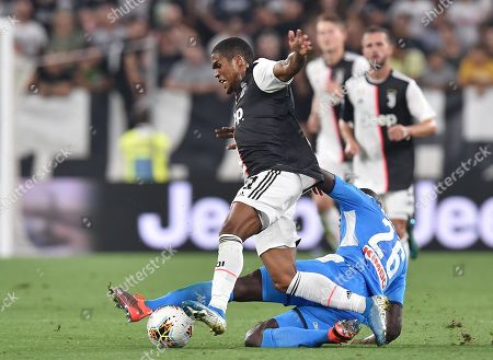 Stock Image of Juventus' Douglas Costa and Napoli's Kalidou Koulibaly in action during the Italian Serie A soccer match Juventus FC vs SSC Napoli at the Allianz Stadium in Turin, Italy, 31 August 2019.