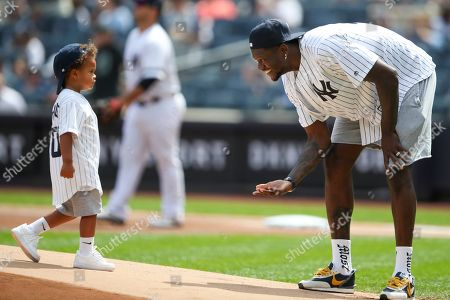 Julius Randle, Kyden Randle. New York Knicks' Julius Randle is joined by his son Kyden on the pitchers mound after he threw the ceremonial first pitch before the start of a baseball game between the New York Yankees and the Oakland Athletics, in New York