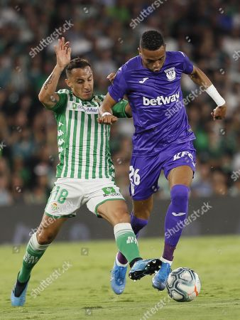 Real Betis' Andres Guardado (L) in action against CD Leganes's Youseff En-Nesyri during a Spanish LaLiga soccer match between Real Betis and CD Leganes at the Benito Villamarin stadium in Sevilla, southern Spain, 31 August 2019.