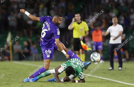 Real Betis' Emerson Royal (R) in action against CD Leganes's Youssef En-Nesyri (L) during a Spanish LaLiga soccer match between Real Betis and CD Leganes at the Benito Villamarin stadium in Sevilla, southern Spain, 31 August 2019.