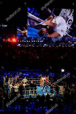 Stock Image of Charlie Edwards vs Julio Cesar Martinez during their WBC World Flyweight Championship fight The fight ends in a no contest after Charlie Edwards was punched while on one knee (displayed on the large screen)