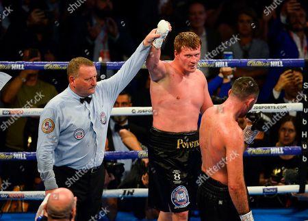 Alexander Povetkin celebrates winning the vacant WBA International Heavyweight Championship fight Hughie Fury