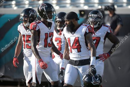 Atlanta Falcons wide receivers Devin Gray (15), Christian Blake (13), Marcus Green (3), Justin Hardy (14) and Olamide Zaccheaus (17) warm up before a preseason NFL football game against the Jacksonville Jaguars, in Jacksonville, Fla