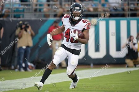 Atlanta Falcons running back Tony Brooks-James (46) reacts after rushing for a touchdown during the first half of a preseason NFL football game against the Jacksonville Jaguars, in Jacksonville, Fla
