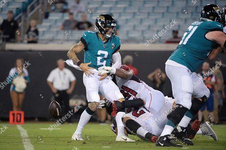 Atlanta Falcons defensive end Chris Odom (91) and defensive end Austin Larkin (62) strip the ball from Jacksonville Jaguars quarterback Alex McGough (2) during the second half of a preseason NFL football game, in Jacksonville, Fla