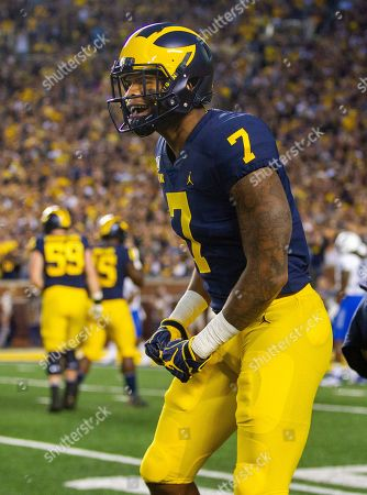 Michigan wide receiver Tarik Black (7) celebrates his touchdown in the first quarter of an NCAA football game against Middle Tennessee in Ann Arbor, Mich